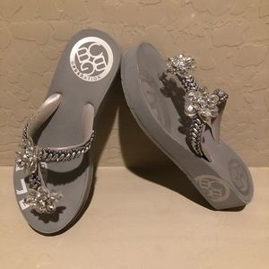 BCBG silver flip flops with flower accents